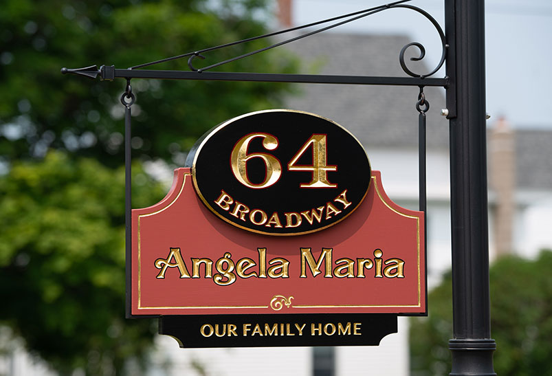 This carved home sign was created for a Victorian Mansion and features carved and 23k gold leaf letters