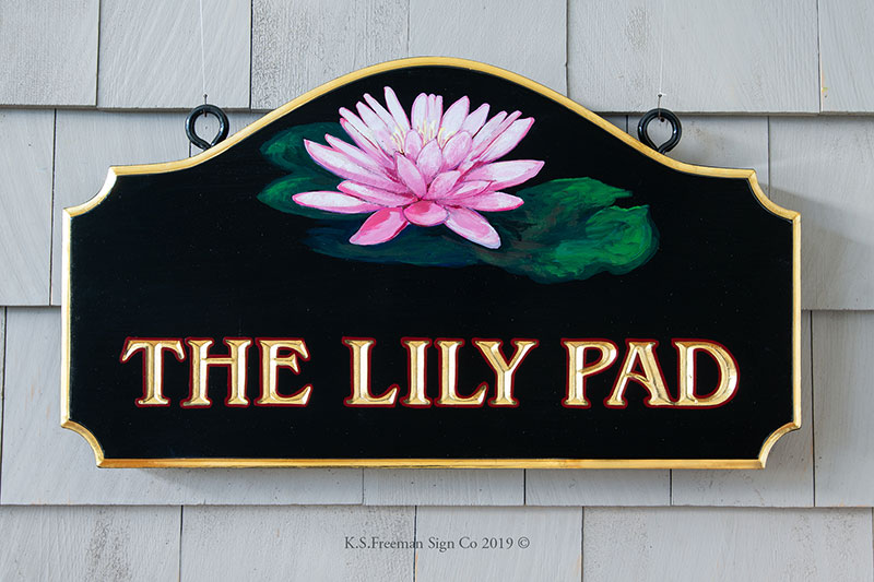 Carved home sign featuring a hand painted lily pad