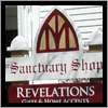This sign for Sanctuary Shops in Ogunquit, Maine incorporates stained glass into its design.