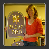 Sandra Freeman with a carved sign