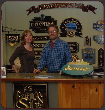 Kevin and Sandra Freeman serve sign customers at Freeman Sign in York, Maine