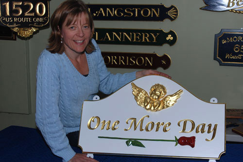 Sandra Freeman displays a unique sign for a special customer with special circumstances