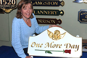 A home sign for a customer in California featuring a hand carved cherub and rose.