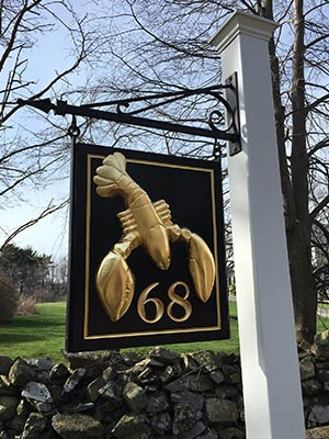 This carved home number features a hand carved lobster gilded in 23k gold leaf.